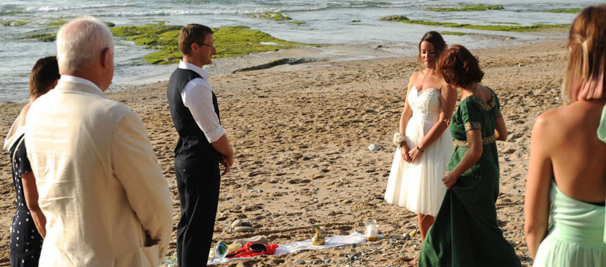 Maori wedding ceremony in a beach, standing in circle
